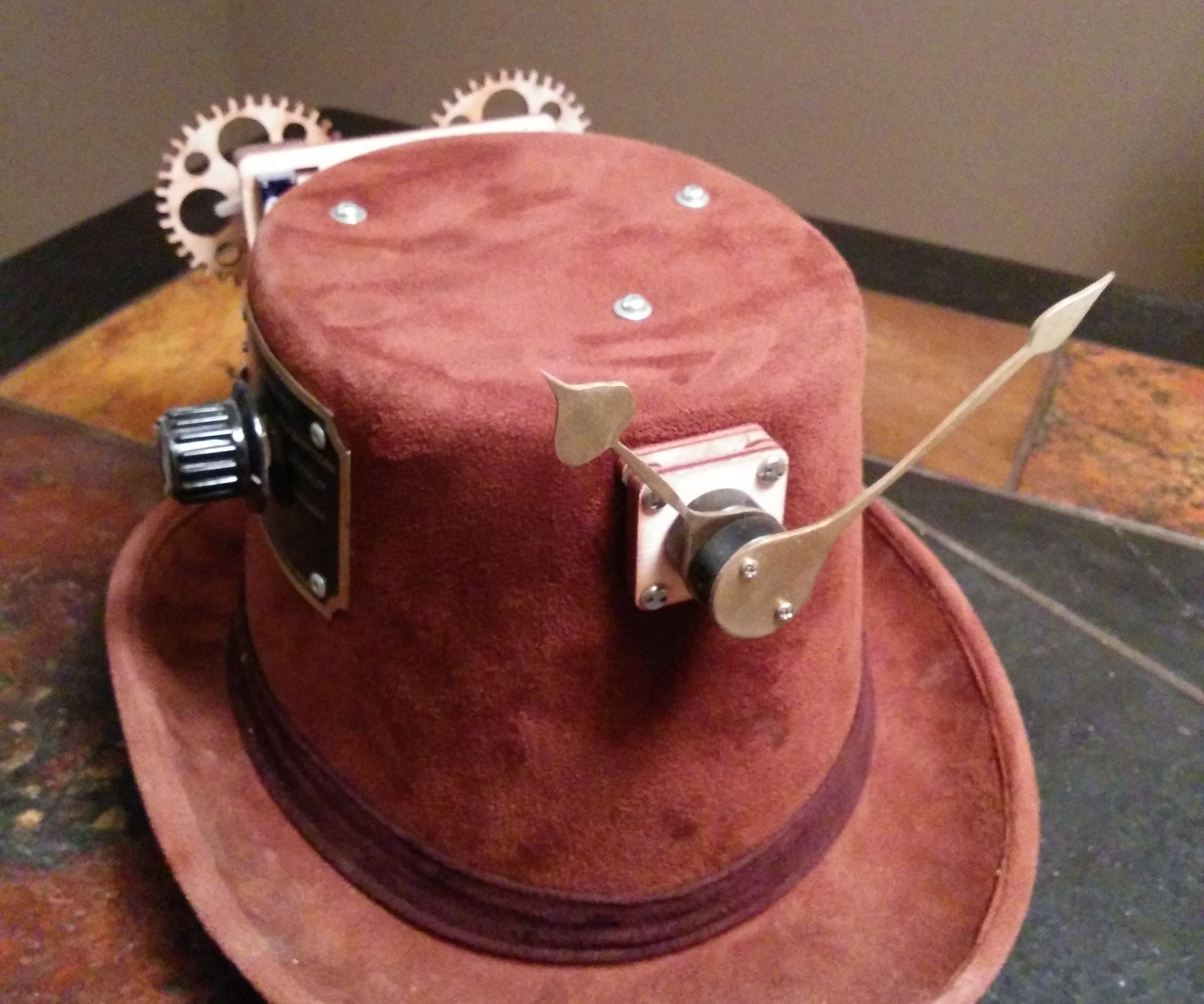 Hat-mounted clock with multiple timezone support and GPS functionality