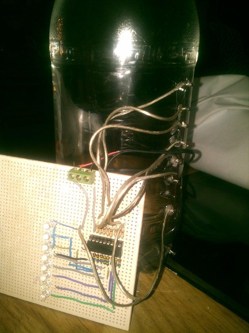 Colocar Los Cables Del Circuito a Los Clavos Del Recipiente.