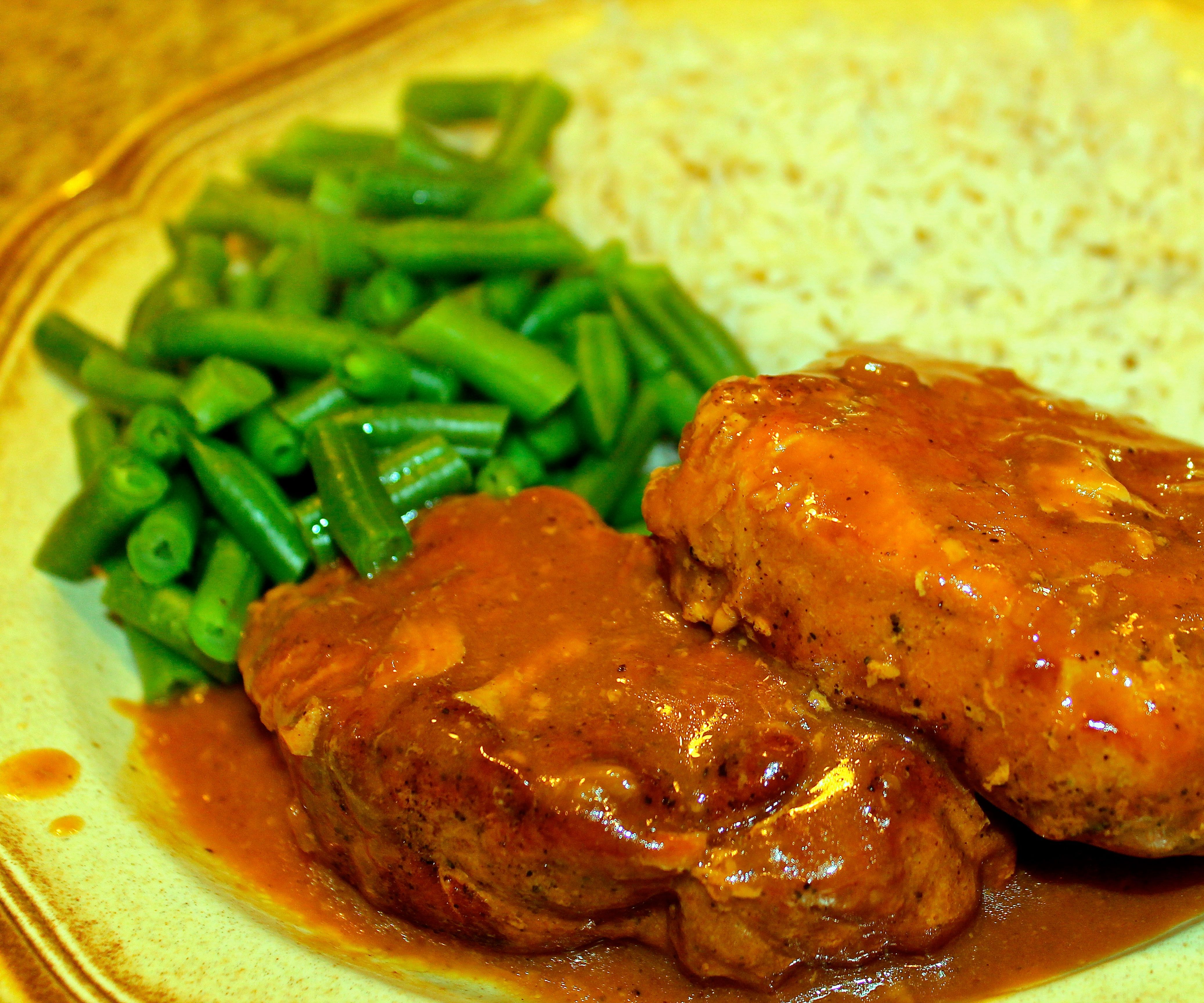 Smothered Pork Chops with Rich Flavorful Gravy