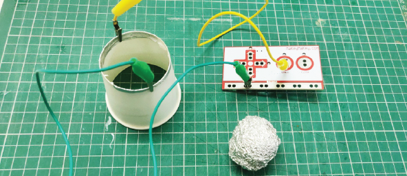 Now Connect the Alligator Clip Wires to the Paper Cup Base (where Foil Strips Are Placed) and to Your Makey Makey Board(Space Key and Ground) As Shown in Figure Below.