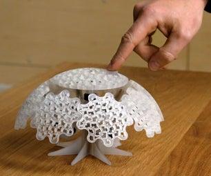 Tiny Planet: a 3D Printed Mechanical Sculpture