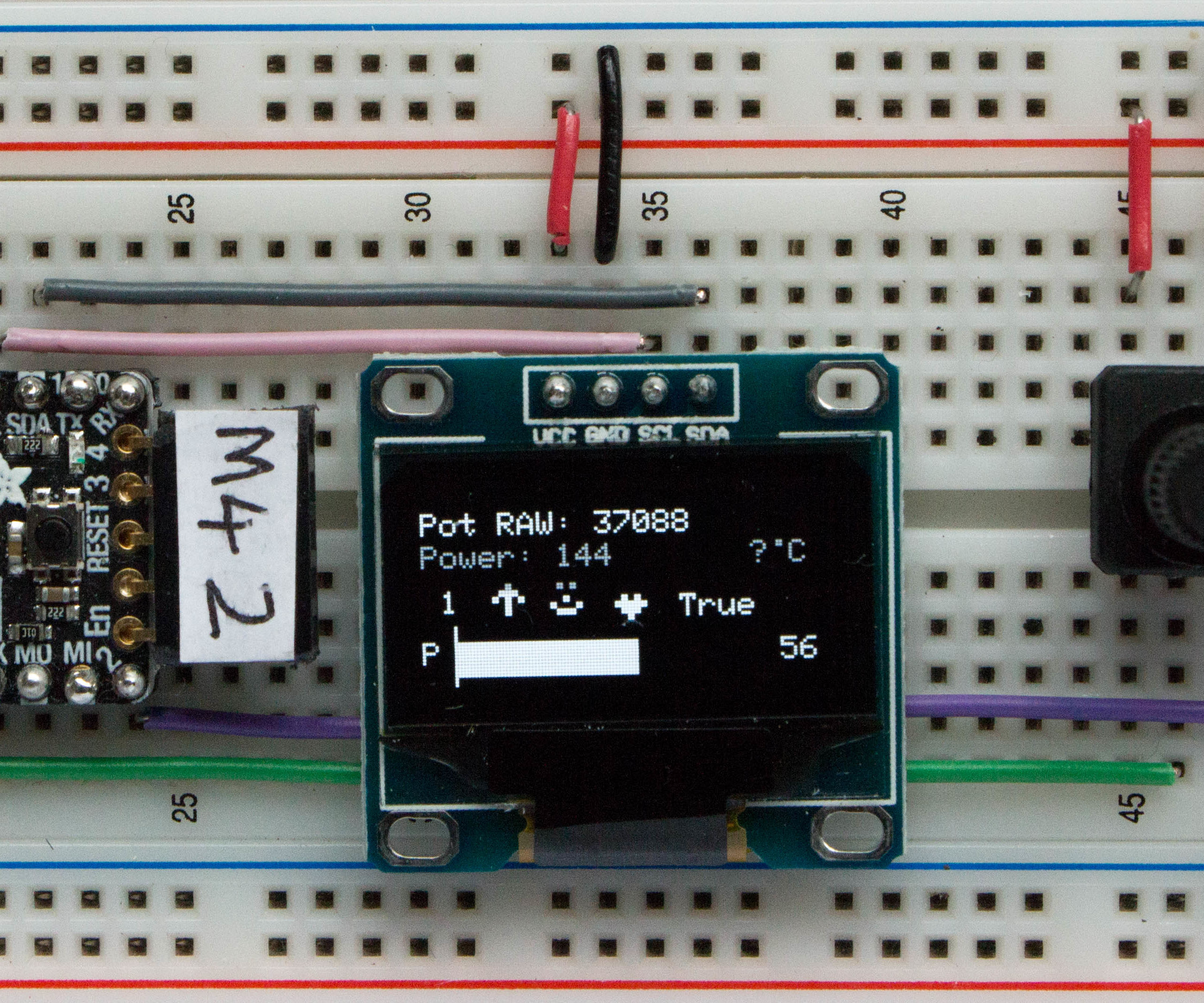 Graphics on a SSD1306 I2C OLED 128x64 Display With CircuitPython Using an Itsybitsy M4 Express