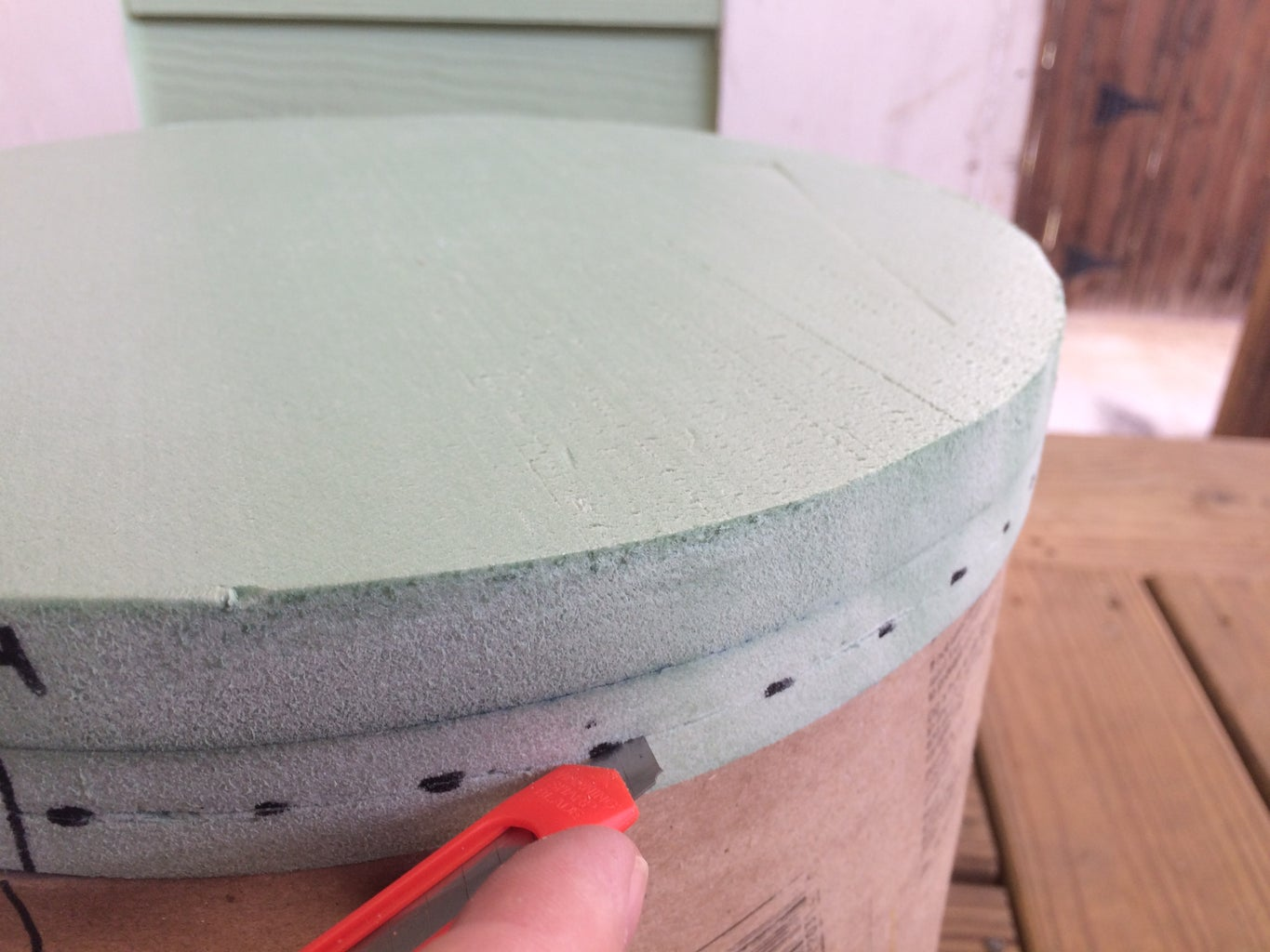 Make a Shallow Cut Along the Dashed Lines on the Edge of the TOP DISC.
