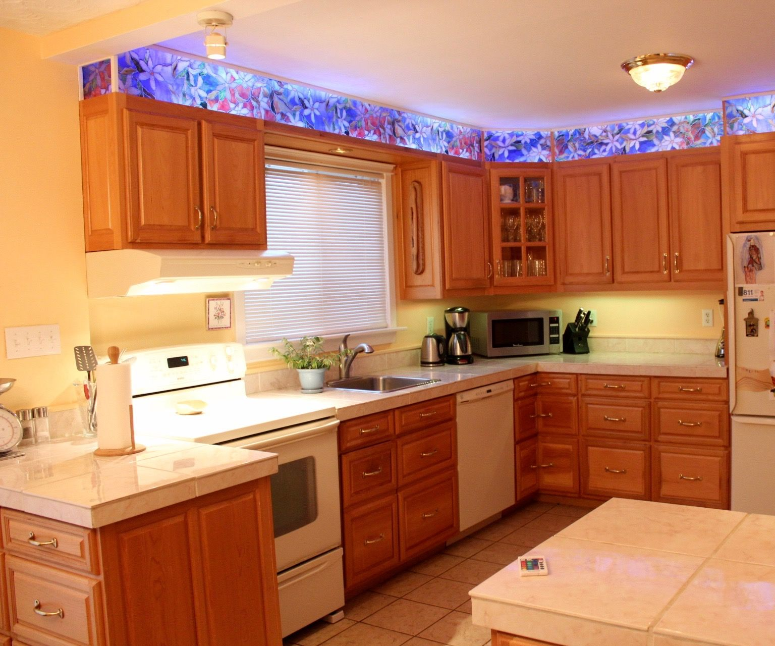 Kitchen cabinet faux stained glass and LED lighting