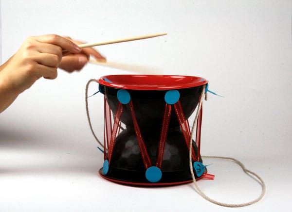 Makedo Beating Drum