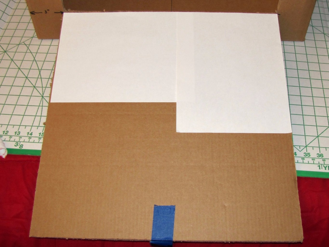 Cover the Interior Surfaces of the Box With Sheets of White Copier Paper