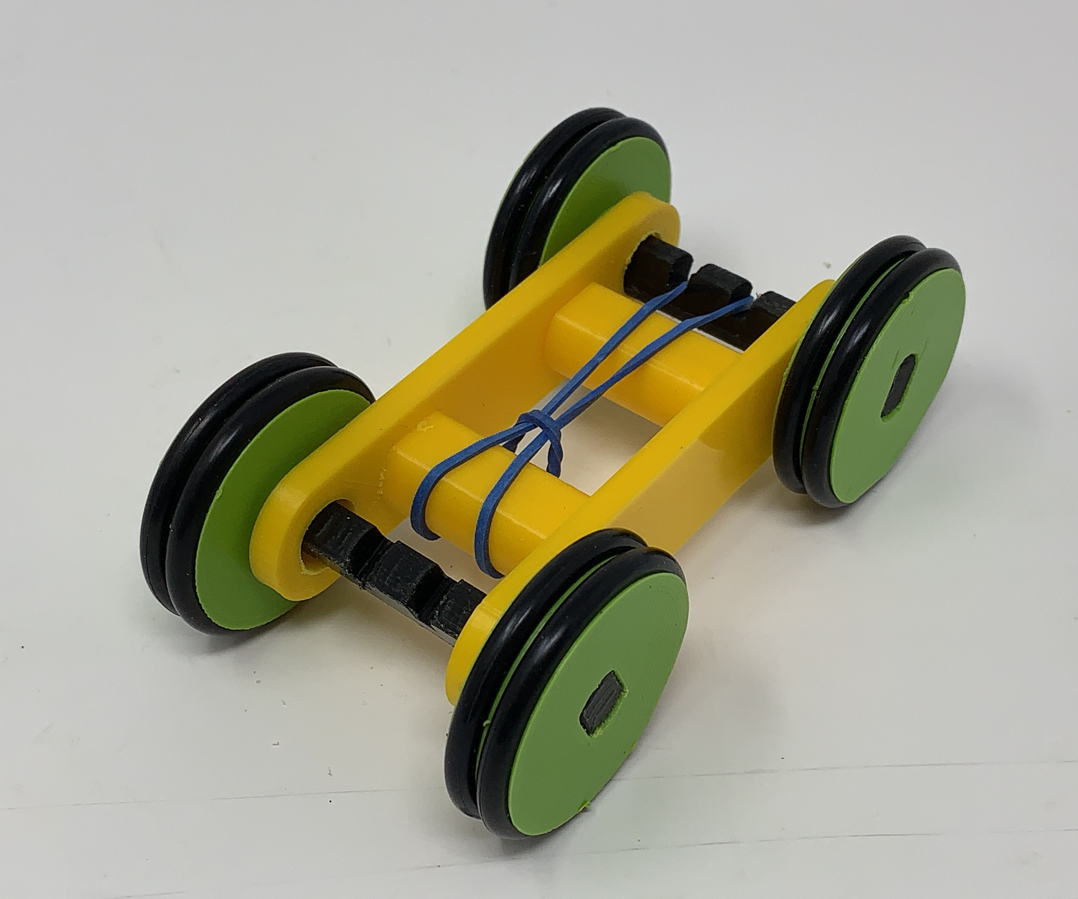 Design a simple 3D printed rubber band car with Autodesk