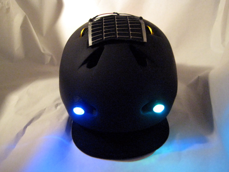 The Green Helmet (Solar powered, safety lit, weatherproof bike helmet.)
