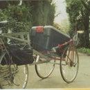 Traffic-warning bike trailer made from a junk bike