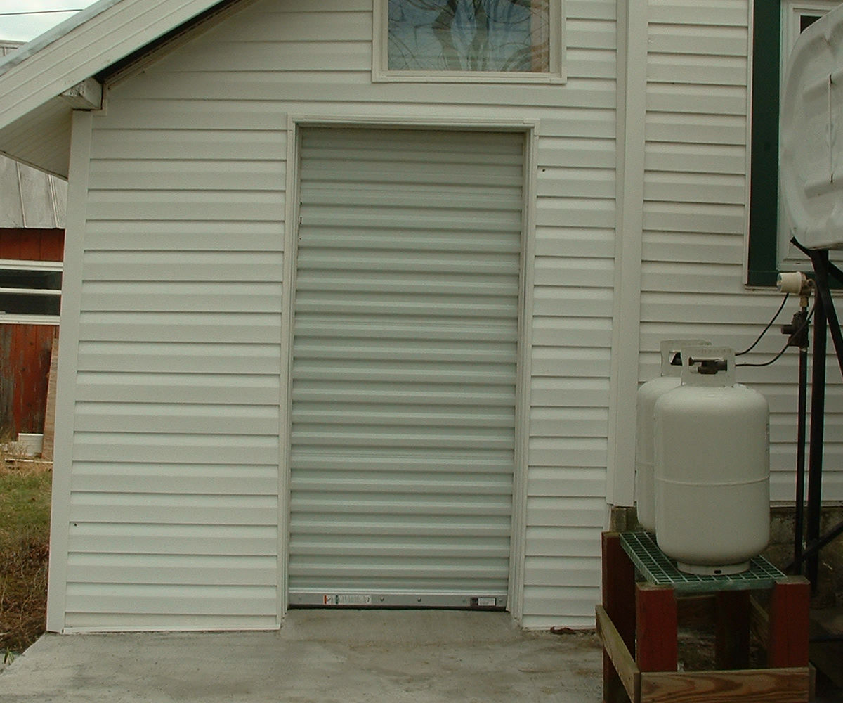 """Installing a Roll Up """"Can"""" Type Door"""