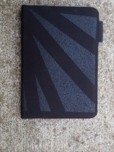 Extra Grip to a Logitech Keyboard, for a IPad Mini.