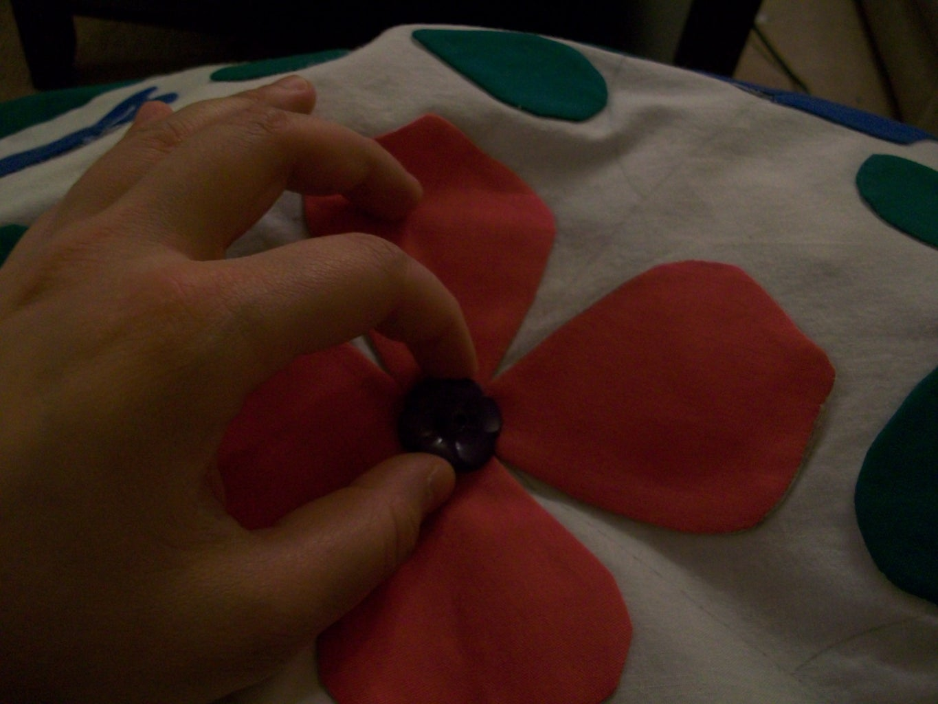 Step 9 - Sew the Buttercups on With the Leaves, and Sew a Button on the Main Center Flower