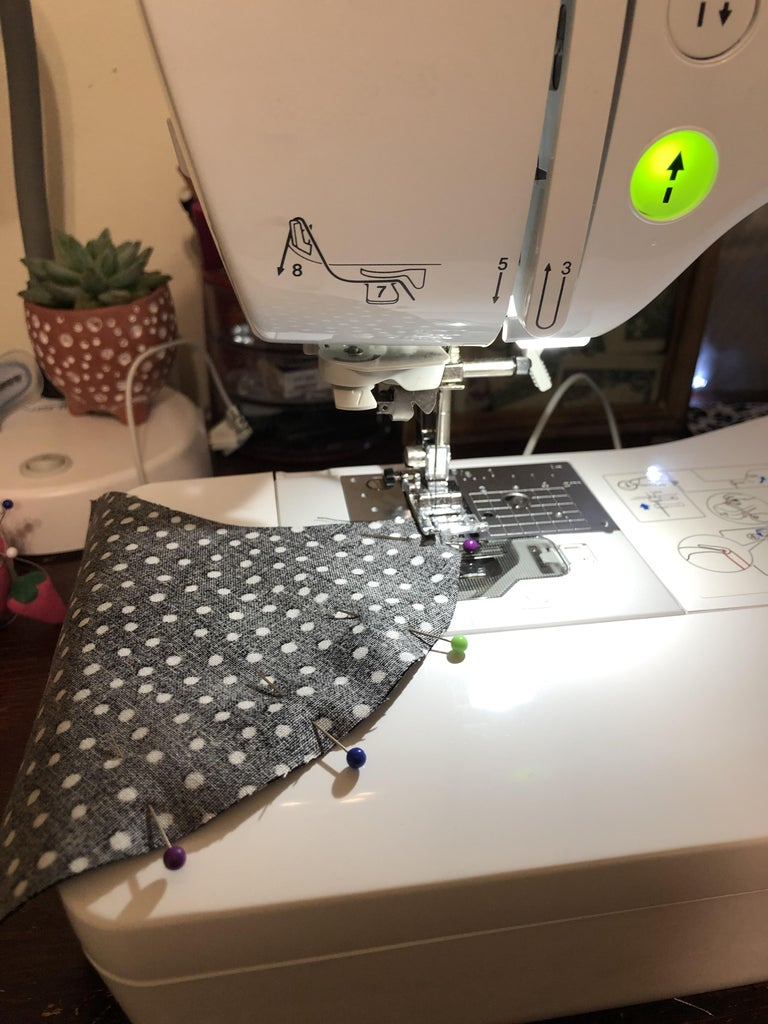 Now You Can Either Sew the Pinned Area by Hand With a Needle and Thread or You Can Use a Sewing Machine.