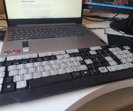 带有三维打印盲文键的计算机键盘