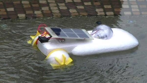 Hybrid Solar-Battery Powered Engine Boat