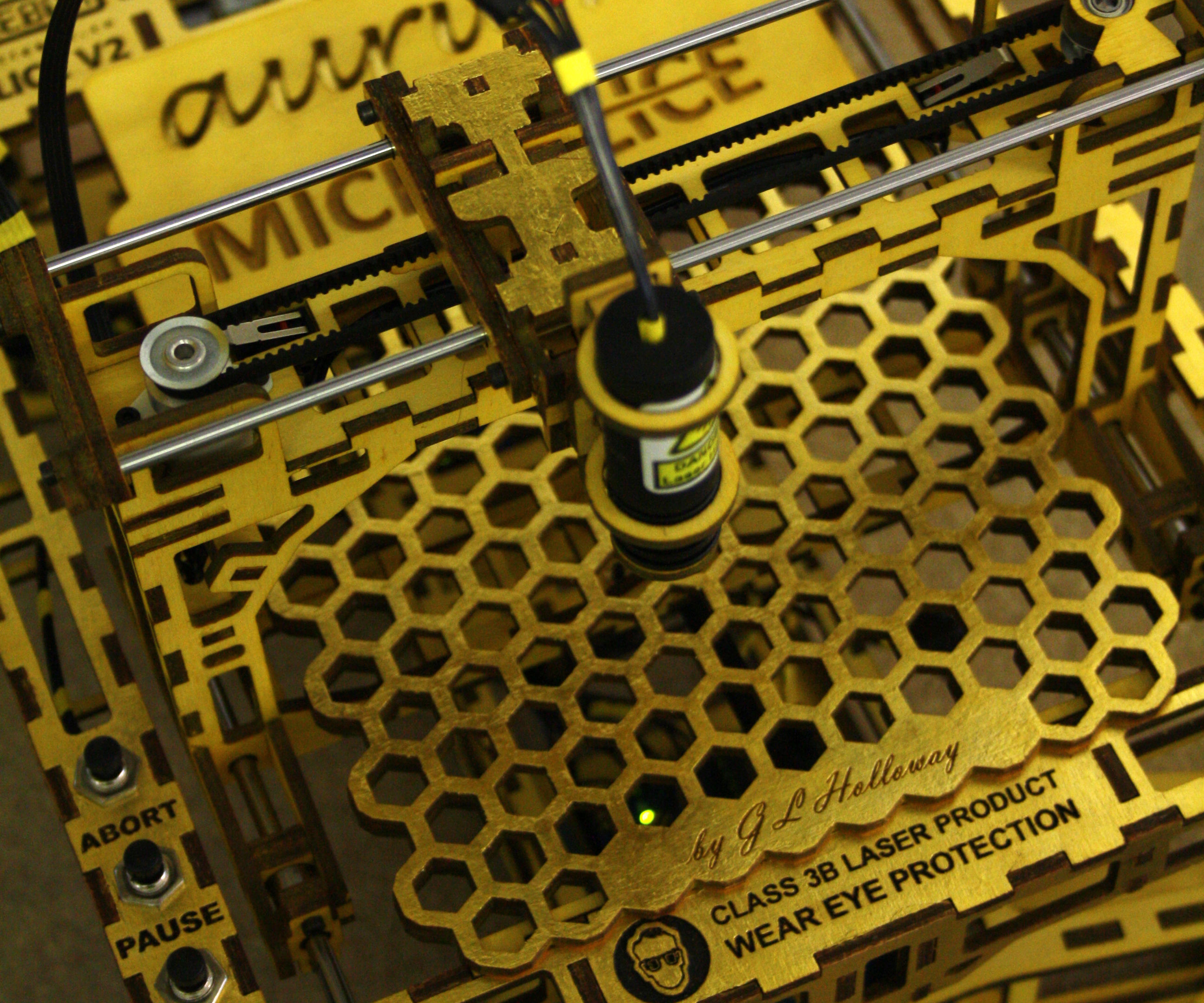 The MicroSlice V2 Aurum | A gold mini laser cutter & engraver.
