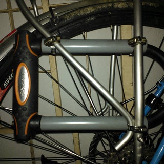 Lock Bracket That Doesn't Interfere With Bottle Cages or Panniers.