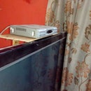 Integrated Space Saving STB Shelf for TV