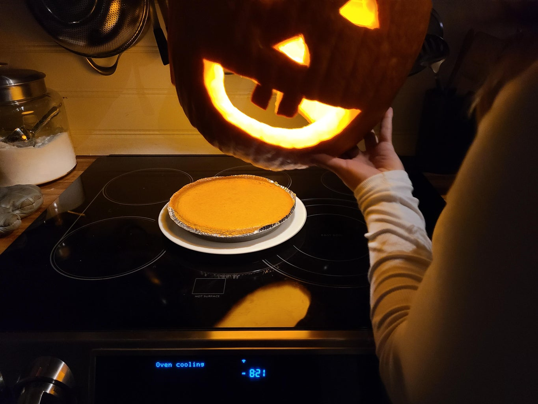 Delicious Pumpkin Pie With Decorative Pumpkin Platter Cover