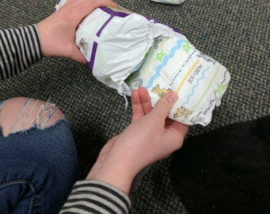 Grab One Fresh Diaper From Package