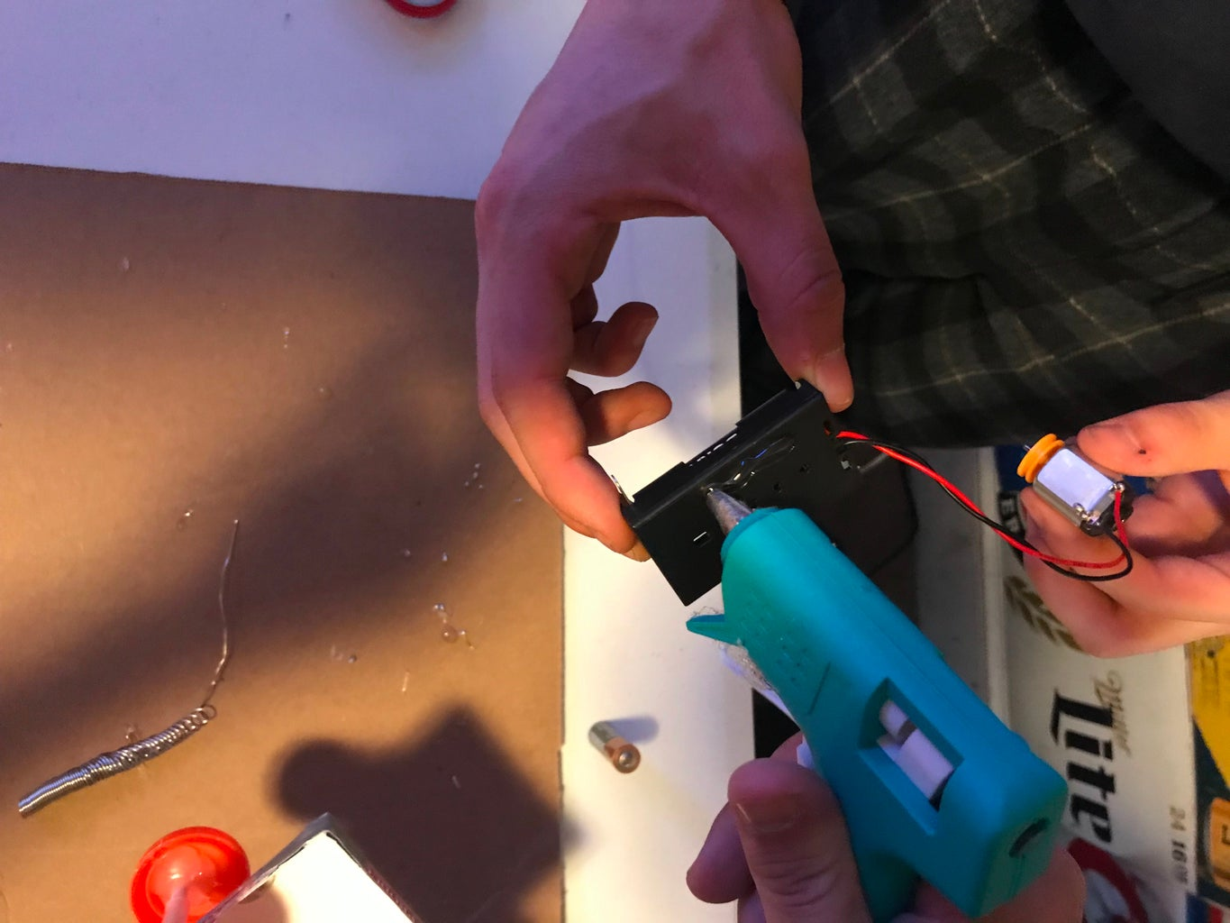 Hot Gluing the Batteries to the Card Box
