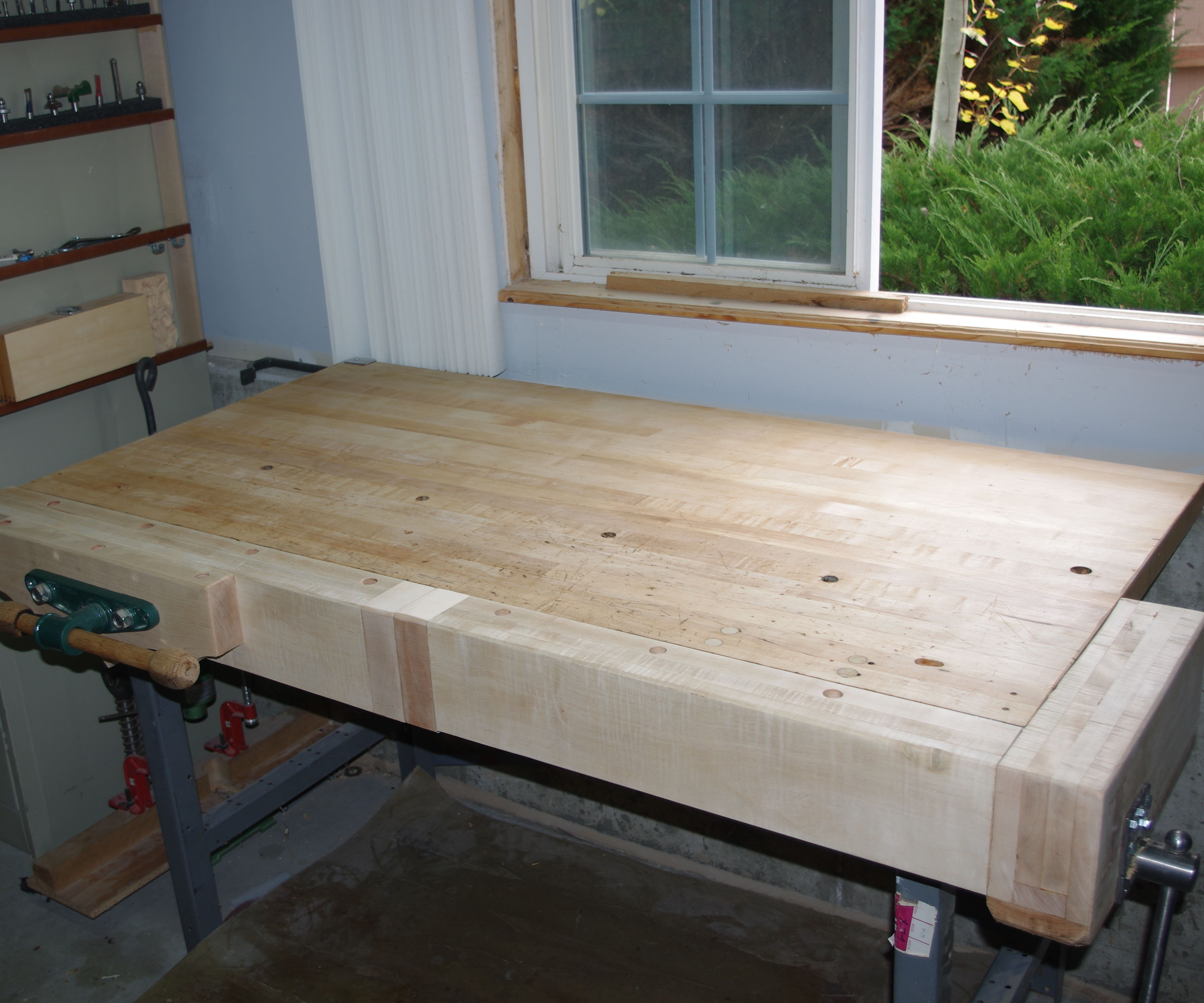 Adding front and tail vises to a maple work table