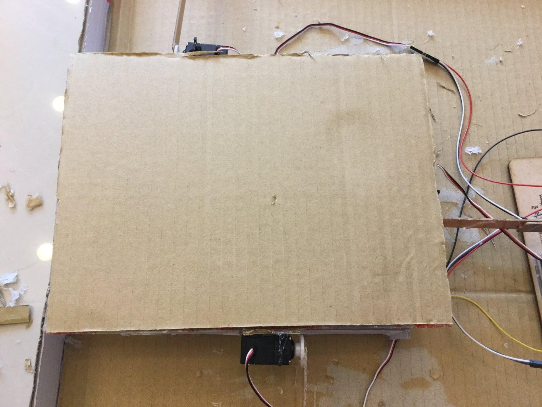 Place Cardboard on the Hardboard
