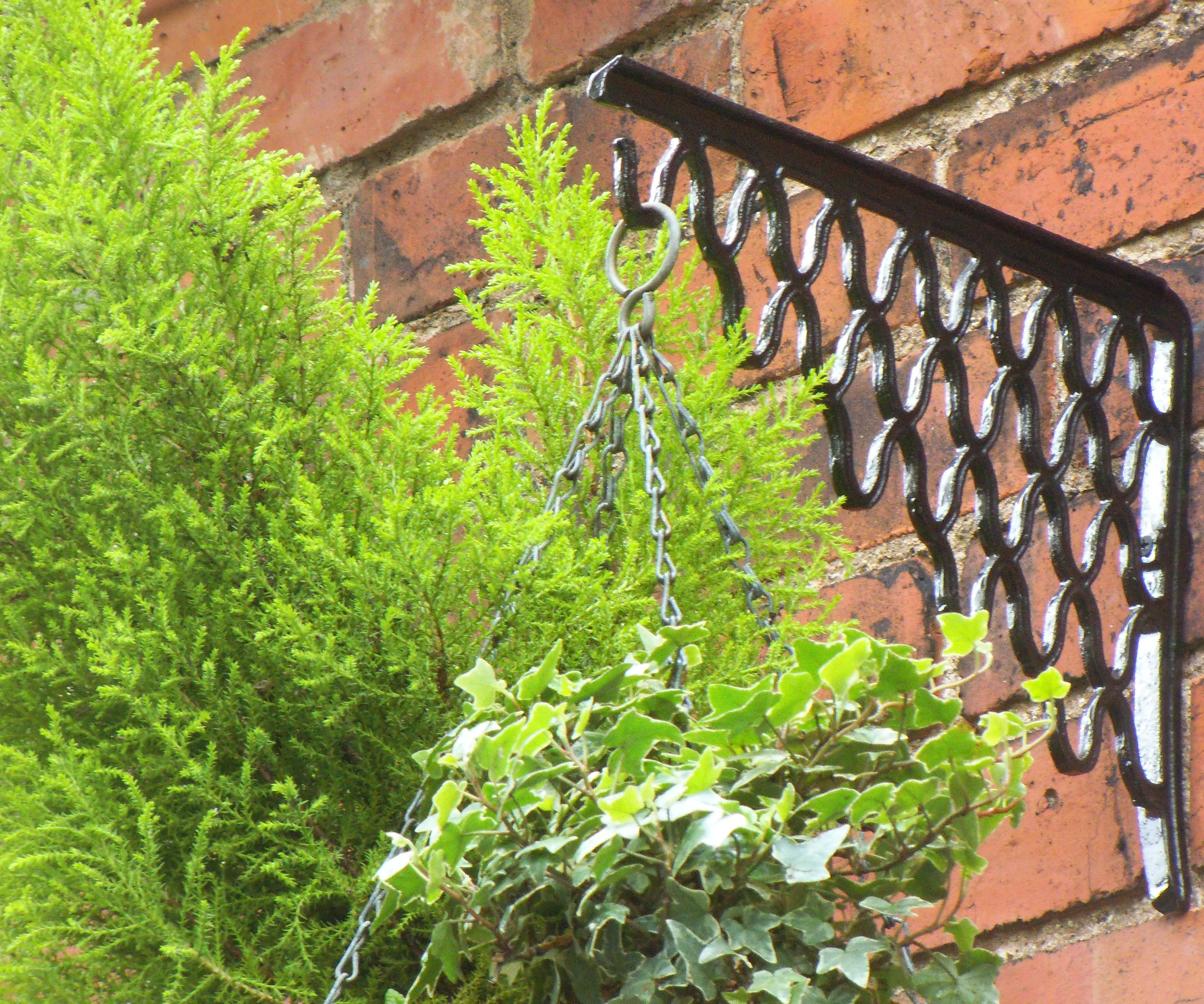 CAST IRON HANGING BASKET BRACKETS FROM ON OLD SEWING MACHINE TREADLE