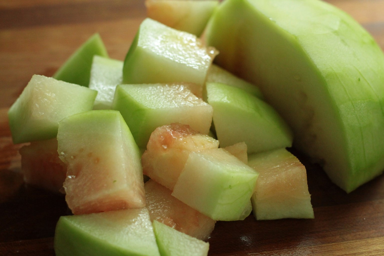 Peel Outer Portion of the Watermelon, Leaving the Green Rind. Then, Chop Into Cubes