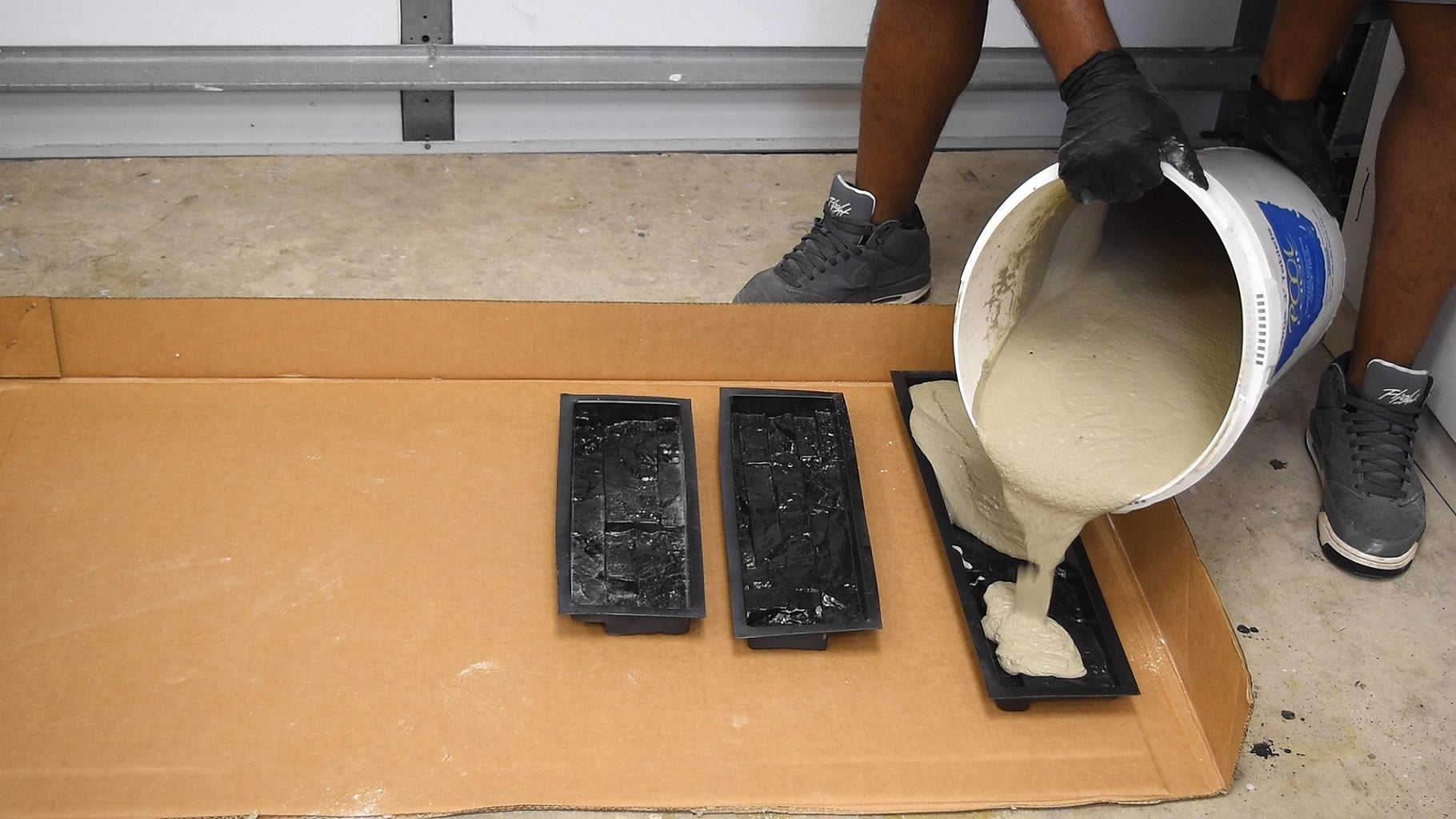 Pouring Cement Into the Molds