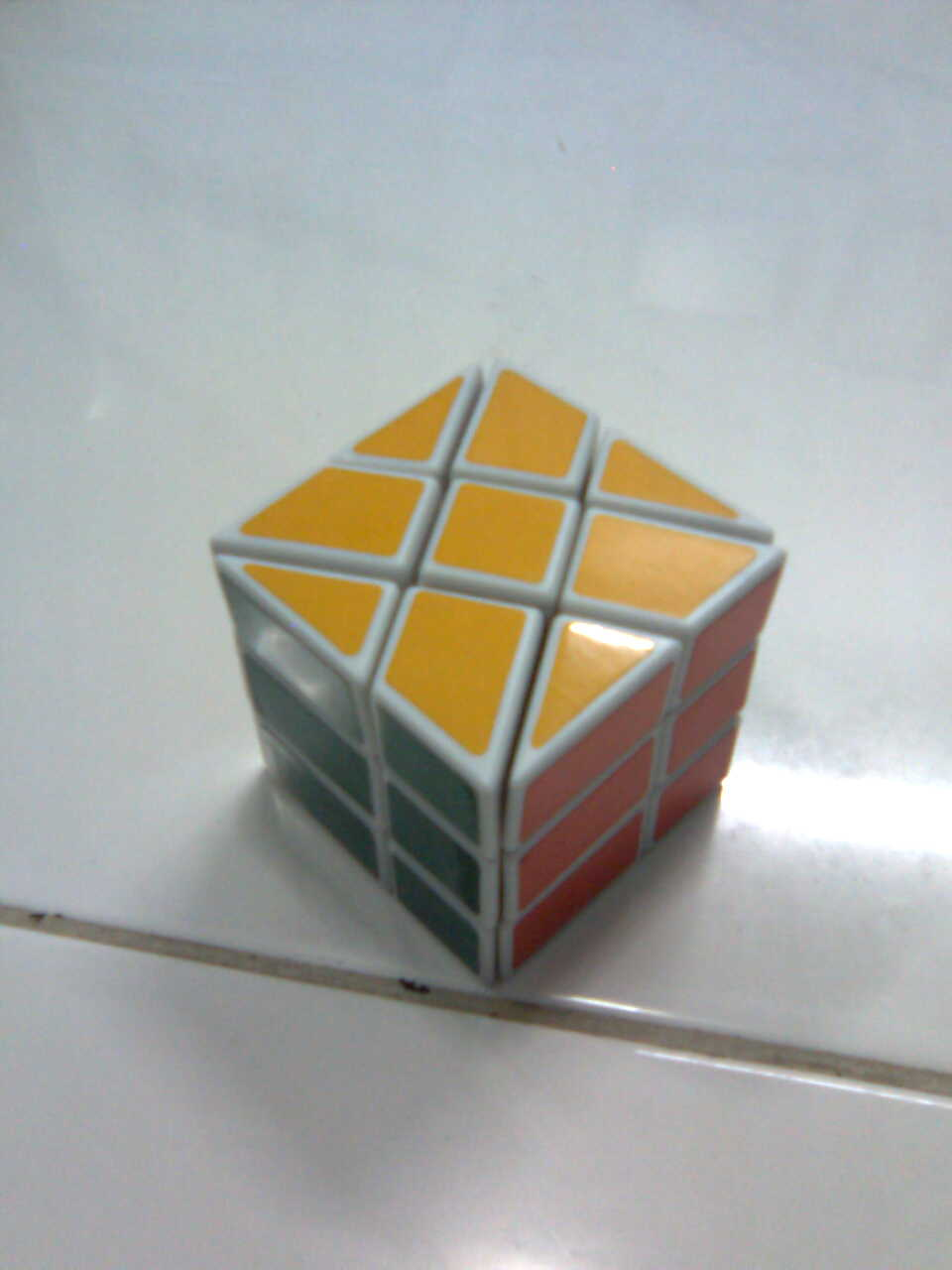 Cube Mechanisms -  the Windmill Cube and the Super Square-1