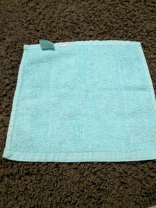 (The Head of the Monkey) Take the Small Towel and Lay It Flat on a Flat Surface.