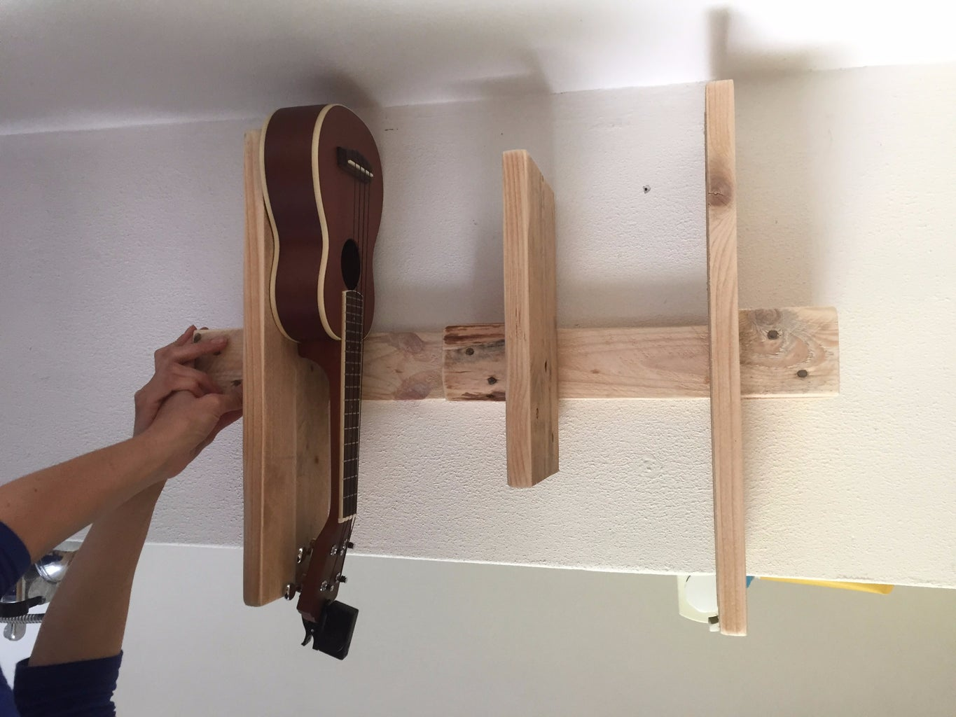Screw in the Shelves, Test Fit It on Your Bathroom Wall With a Ukelele