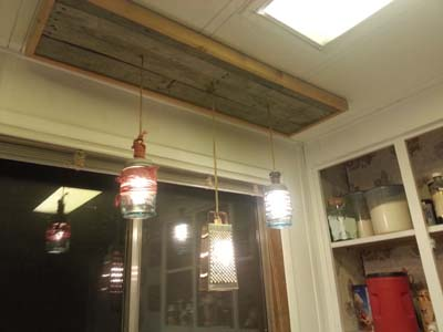 Over sink lighting revamped using pallets and old kitchen items