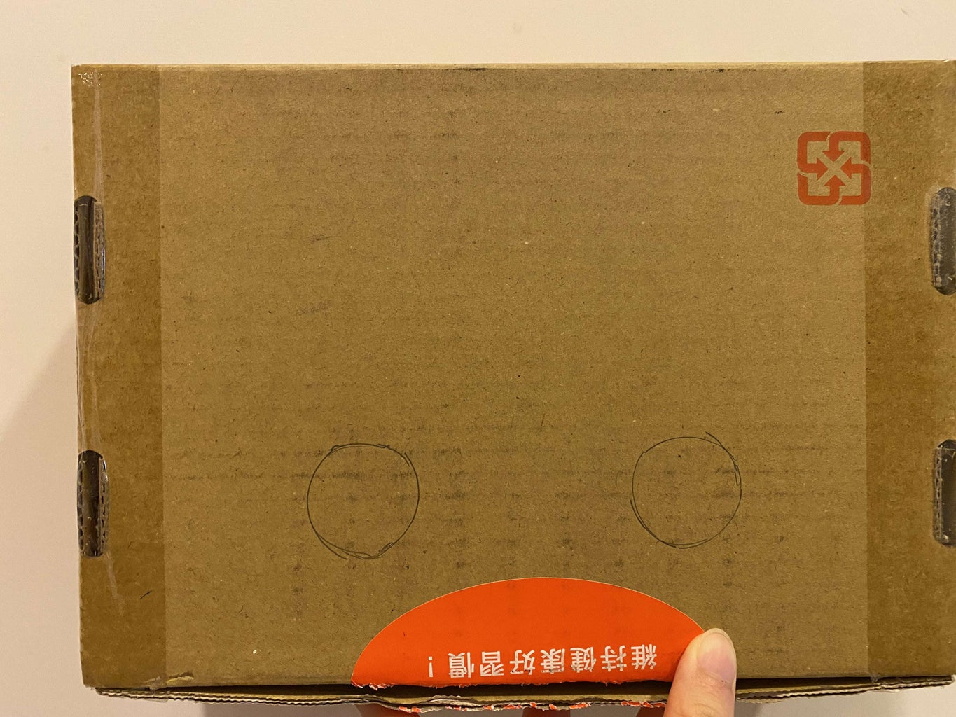 Cut Two Holes on the Box for the Button's Placement