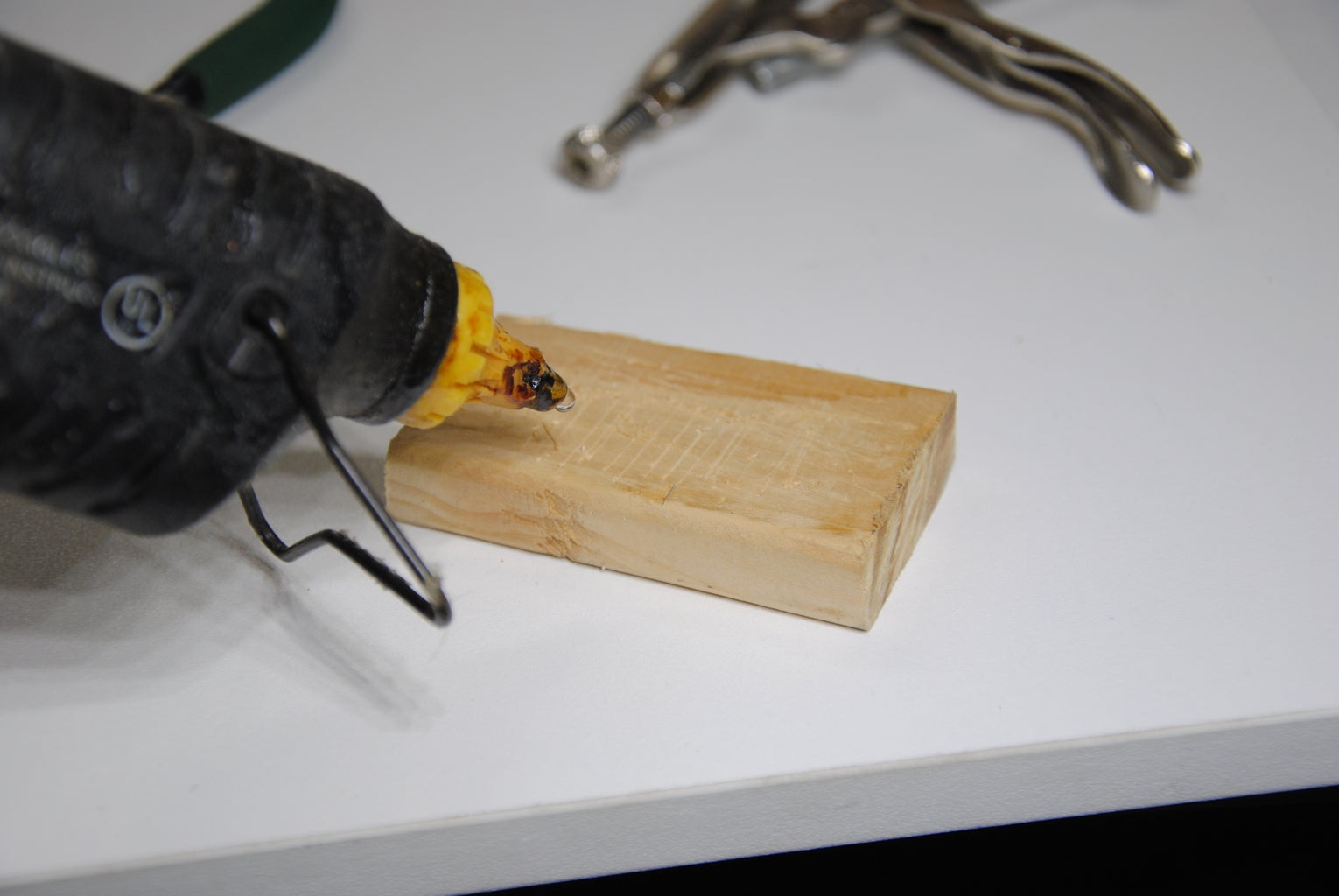 Glue the Wooden Pad Onto the Hammer