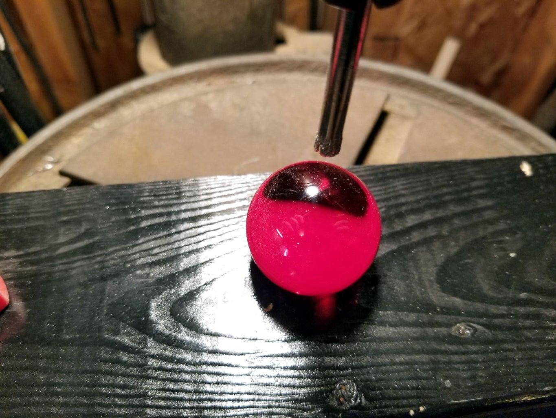 Drill Hole Through Marbles