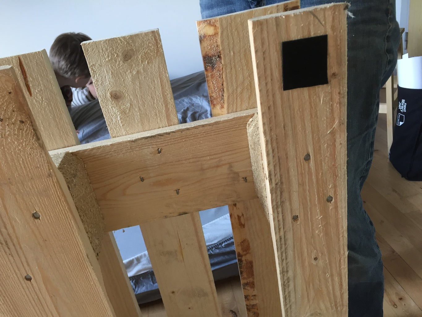 Put Rubber or Felt Pads on the Bottom of the Bed Pallets