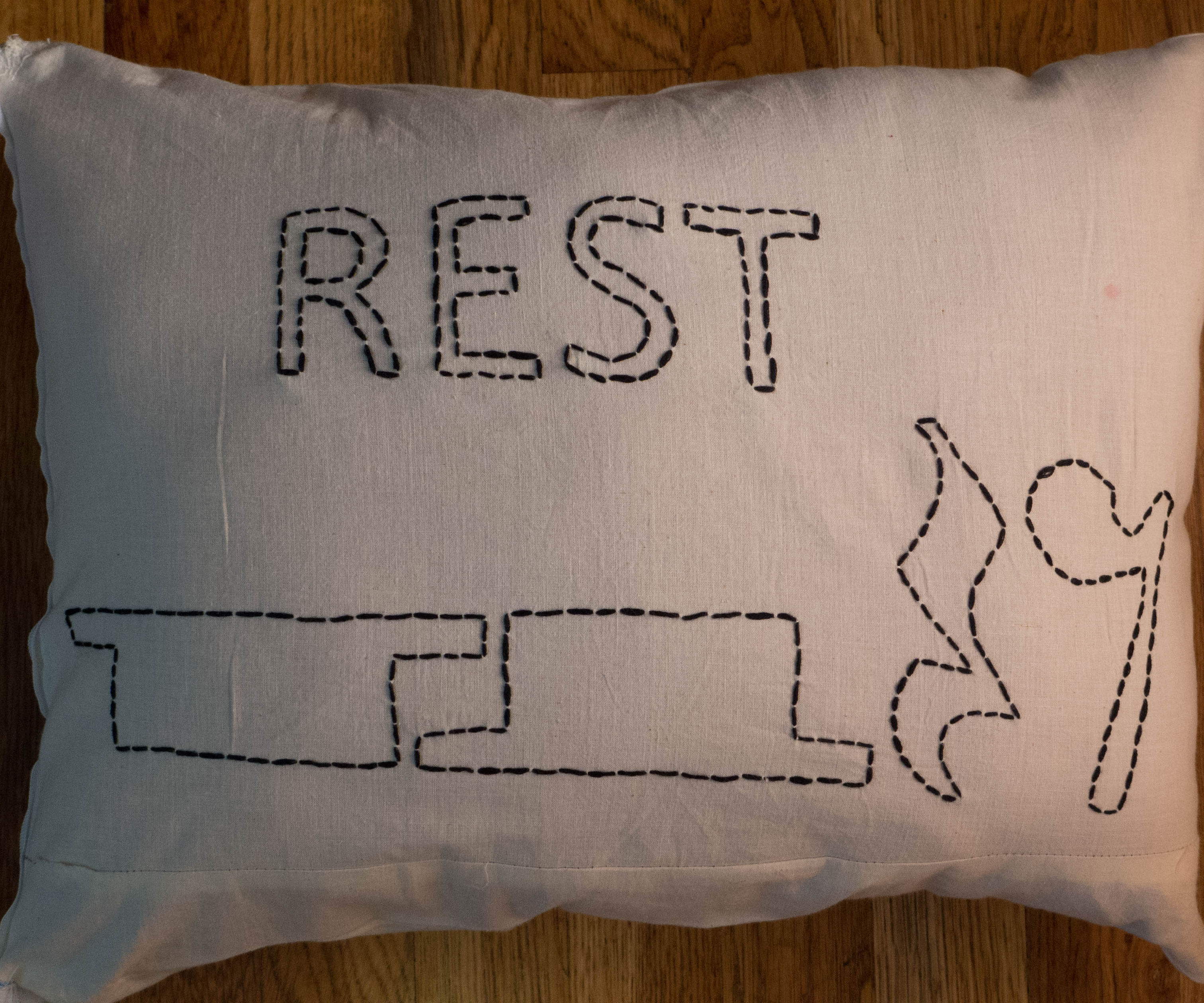 "Embroidered ""Rest"" Pillow"