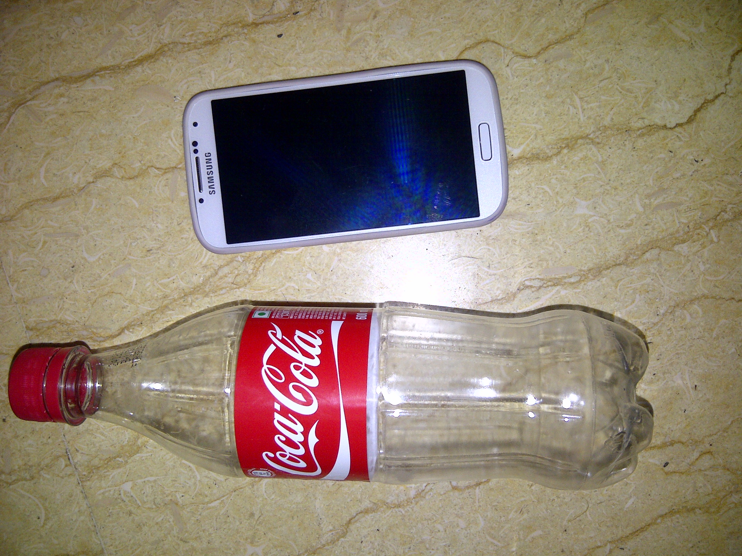Simplest Convenient (Almost Free) Loudspeaker for all Mobile phones + a Complimentary Tumbler/Vessel( Jugaad Technology)