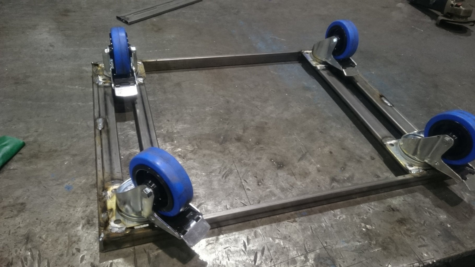 A Dolly Is Welded From 30x10x2 Metal Tubes and Flightcase Wheels