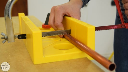 Cutting the Copper Pipes to Size and Drilling Holes Into the Wood for Them