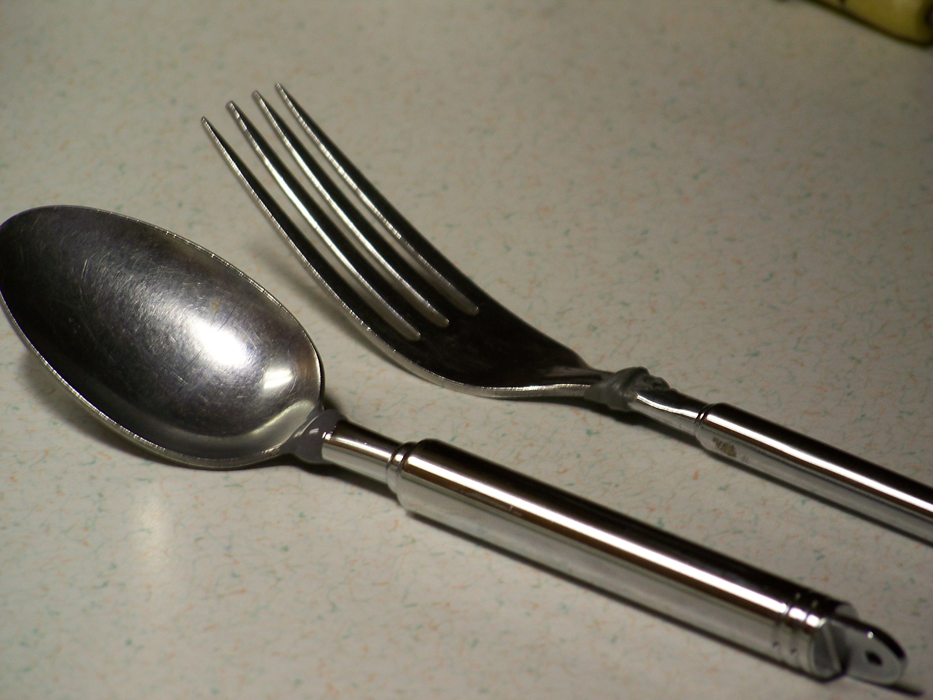 Pocket sized collapsible eating utensils.