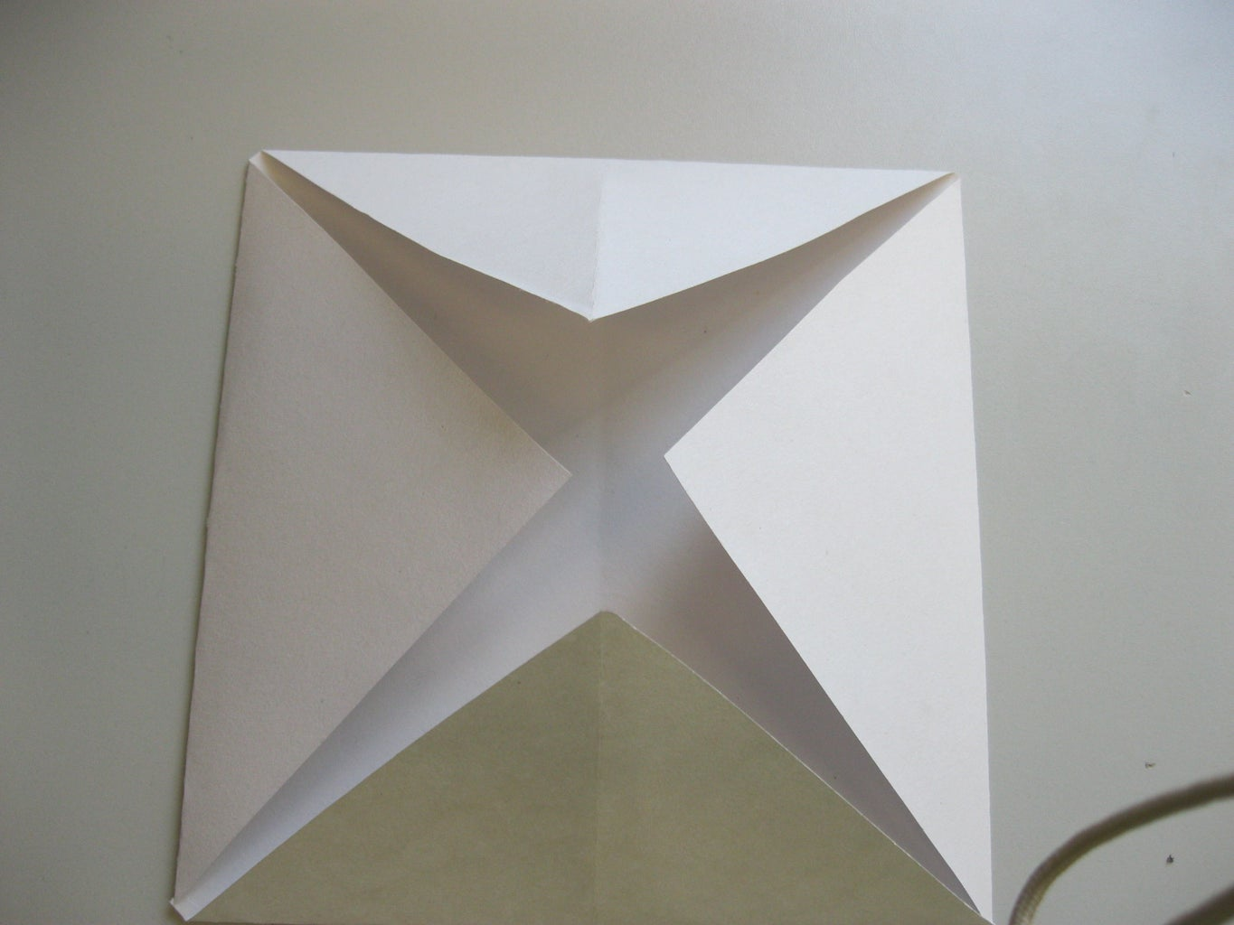 Folding the First Set of Corners