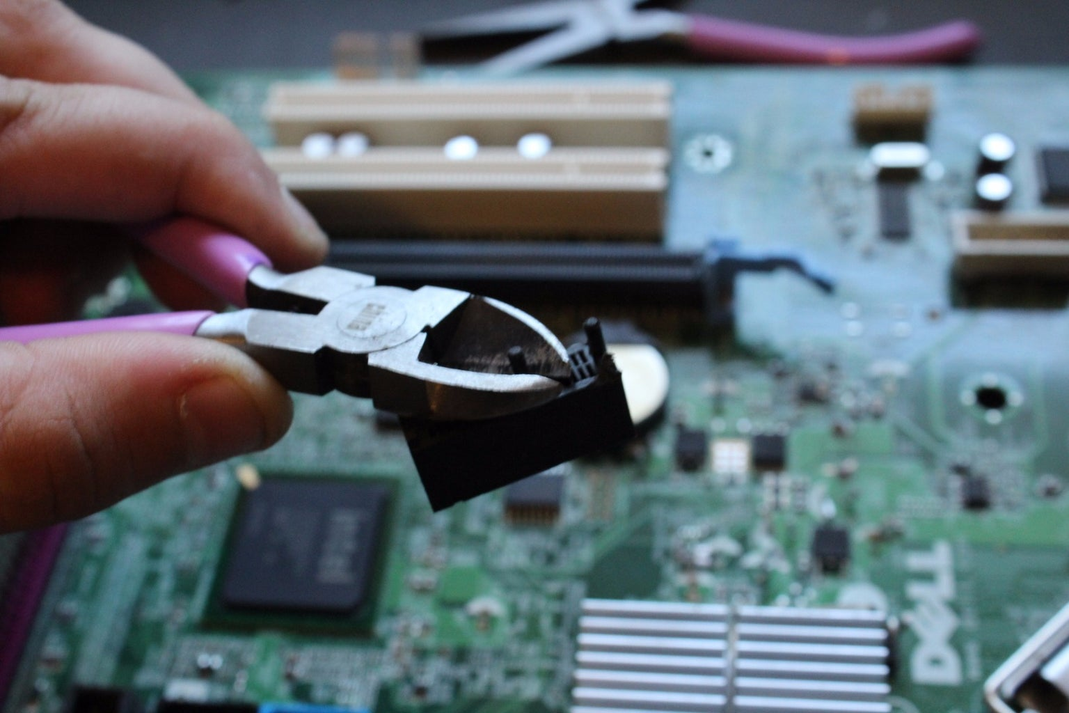 Disassembling Your Motherboard:  Removing Ports