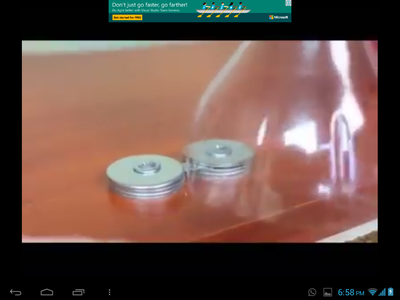 PUT THE PLASTIC BOTTLE ON THE SHARPENER BLADE AND KEEP ROTATING IT SO THAT THE PLASTIC CAN BE CUT INTO ROPE.