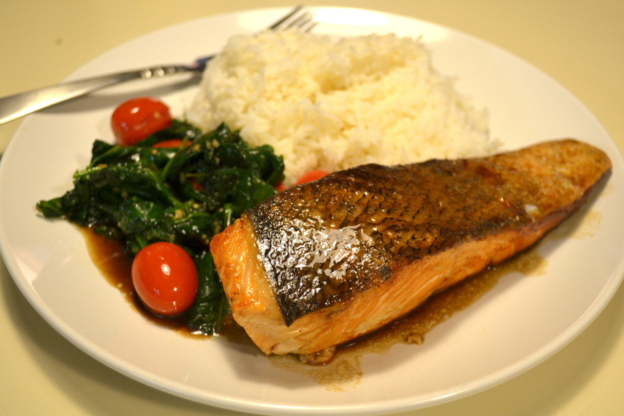 Pan seared salmon with sauteed spinach over jasmine white rice
