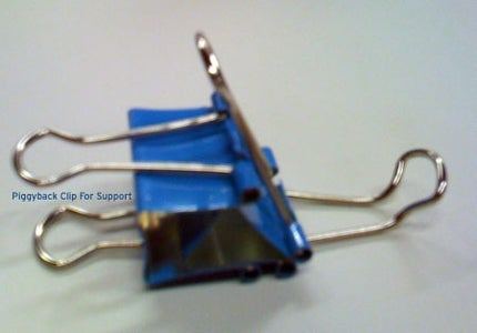 Take the Second Binder Clip and Piggy Back It Onto the First Stand