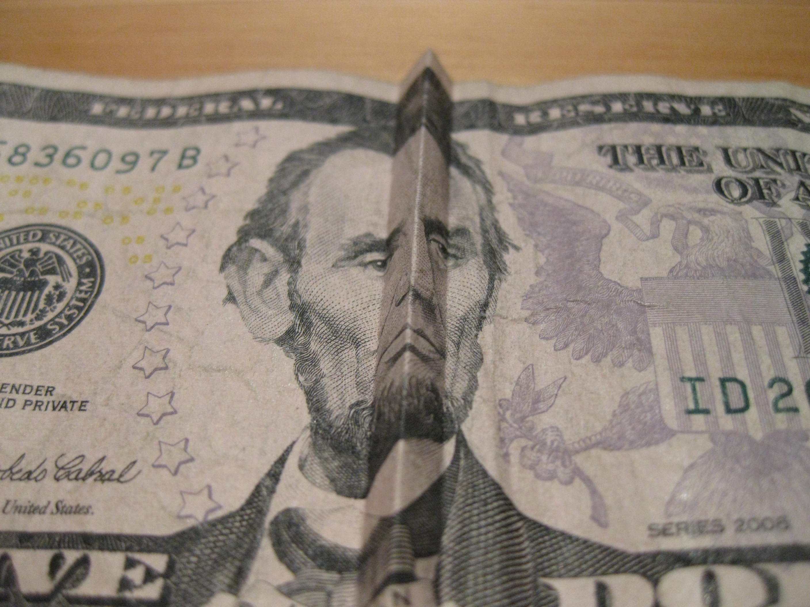 Money Tricks:  How to make Abe Lincoln (on the $5 bill) smile and frown.