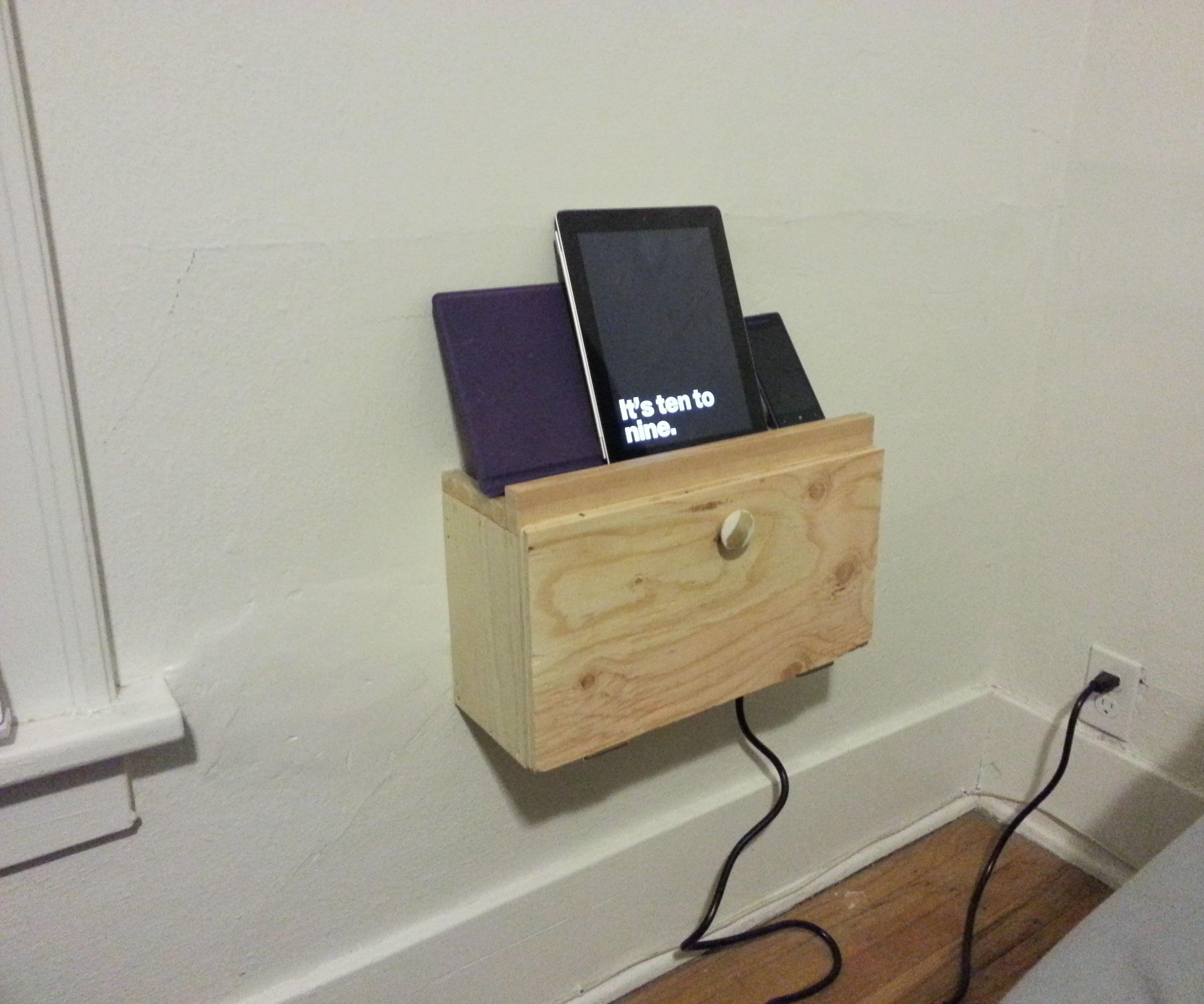 An ugly but easy wall mounted charging docking station